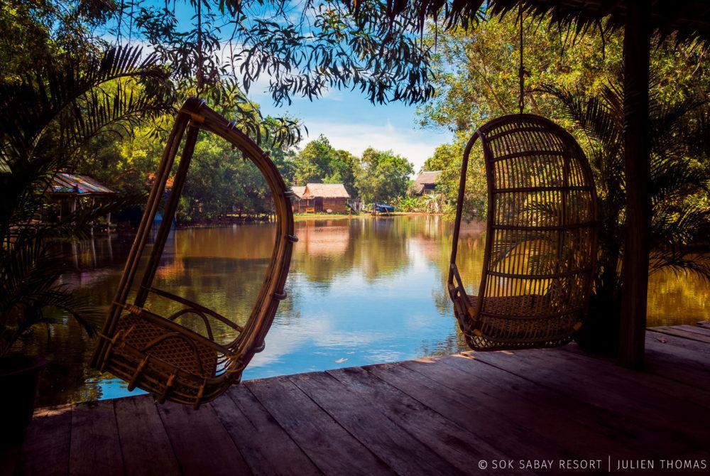 Relaxing area in the resort restaurant facing the Otres River at natural vegetation in Sok Sabay Resort, Otres Village - Cambodia.