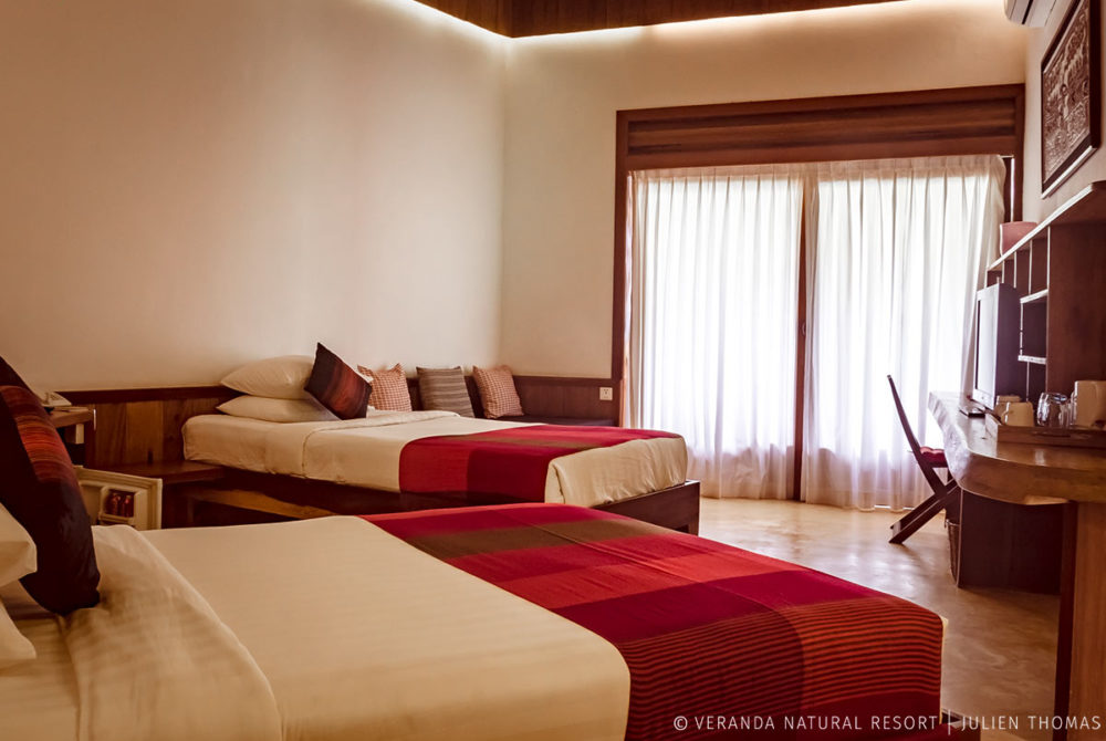 Cliff Twin bedroom, with a private terrace, air conditioner, small fridge, flat televisor and more at the guests disposal in Veranda Natural Resort.