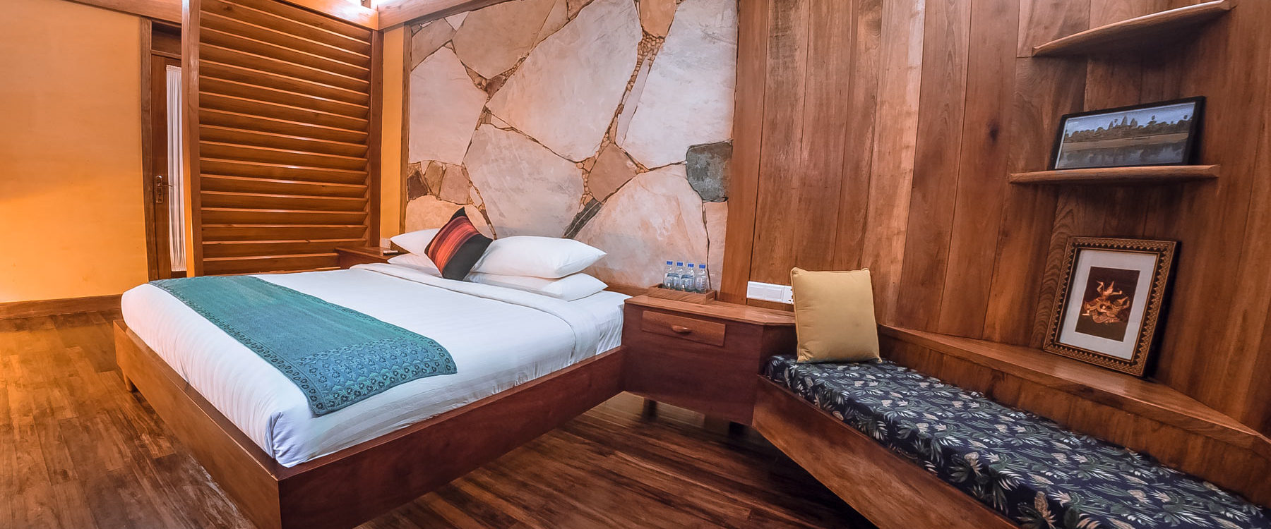 Pool Villa Bedroom, design with natural - wooden parquet, mineral stones, a chill out bench and lots of commodities for the guests in Veranda Natural Resort.