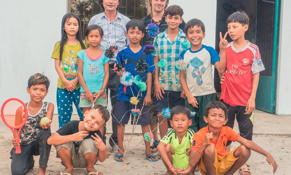 Children have created plastic flowers from plastic recycled plastic waste during a crafty and educational project in Shine Cambodia by Julien Thomas