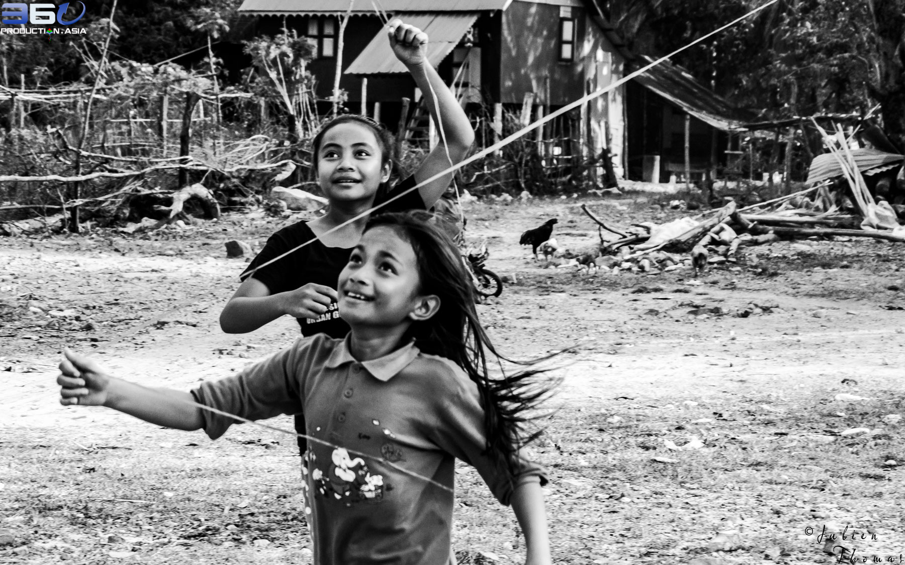 Participating schoolgirls are happy to play and flying their kites they have created using plastic waste during a fun filled ecological course in Cambodia.