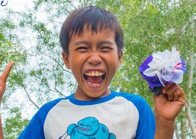 happy-schoolboy-plastic-waste-flower