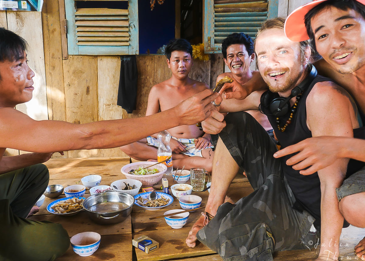 Julien Thomas encounter Vietnamese people in their house and having a snack during another travel in Southeast Asia.