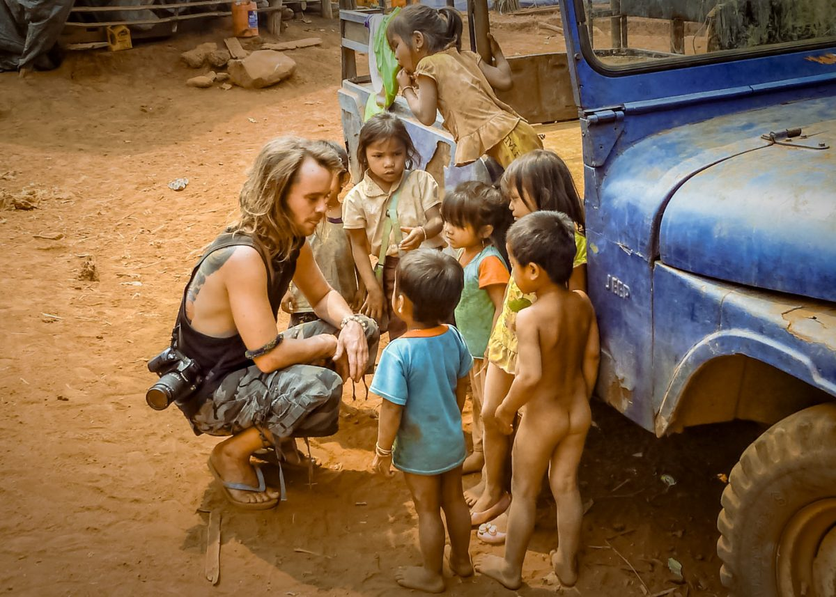 Julien Thomas encounter Katou minority children in their remote village out off the beaten tracks in Laos.