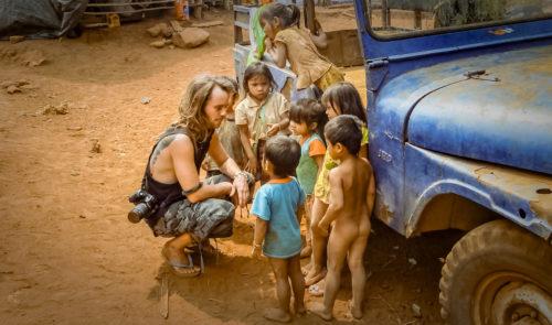 Julien Thomas encounter Katou minority children in their remote village out off the beaten tracks in Laos.