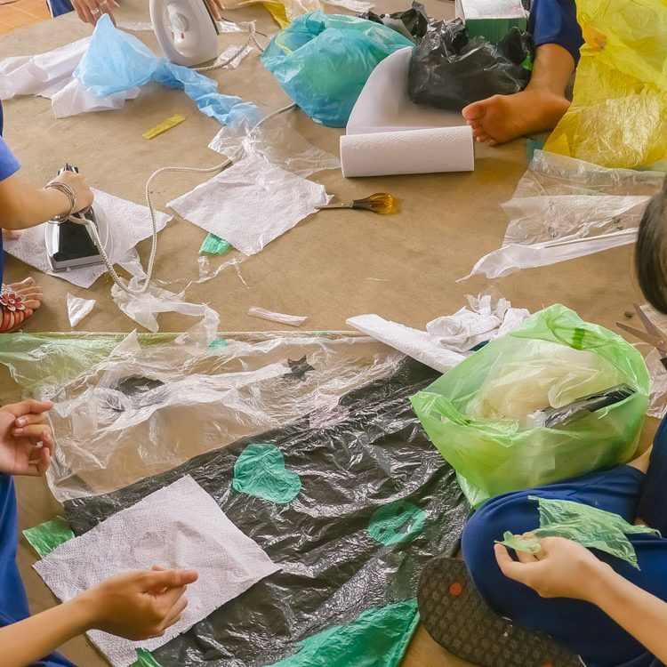 Vietnamese schoolchildren are crafting, working and decorating a homemade kite made with plastic waste during a fun filled ecological course in Ho Chi Minh City.