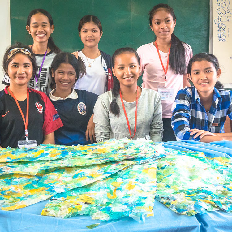 Students have finished to craft the shape of their children's purses from recycled plastic waste during a creative and ecological course children in Cambodia.