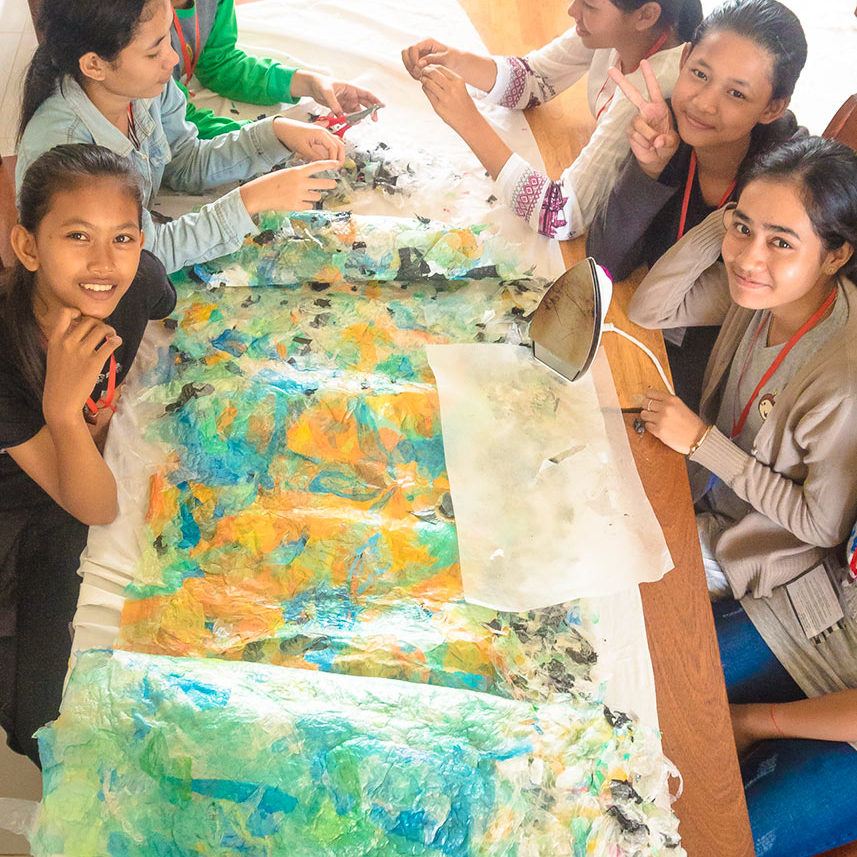 Schoolgirls are working on transforming plastic waste to children's craft at school during an ecological and creative course in Phnom Penh - Cambodia.