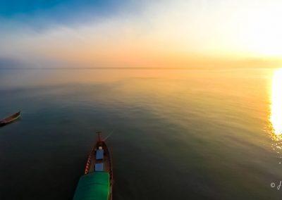 sunrise-boats-shining-ocean-aerial