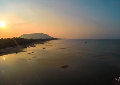 sunset-coastline-island-ocean-aerial