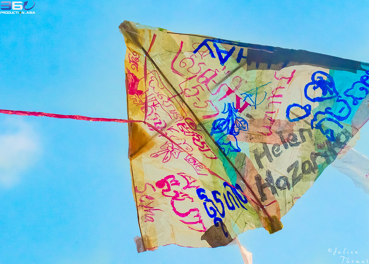 Donor's reward for the crowdfunding campaign of I Believe We Can Fly Project. His name is written on a kite for children made by a kid using plastic waste.