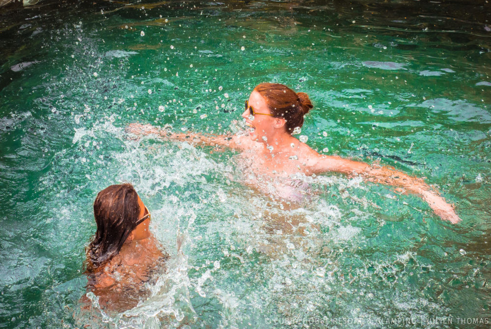 Guests playing in a fresh water swimming pool in Cubby House Resort & Glamping, Otres Village - Cambodia.