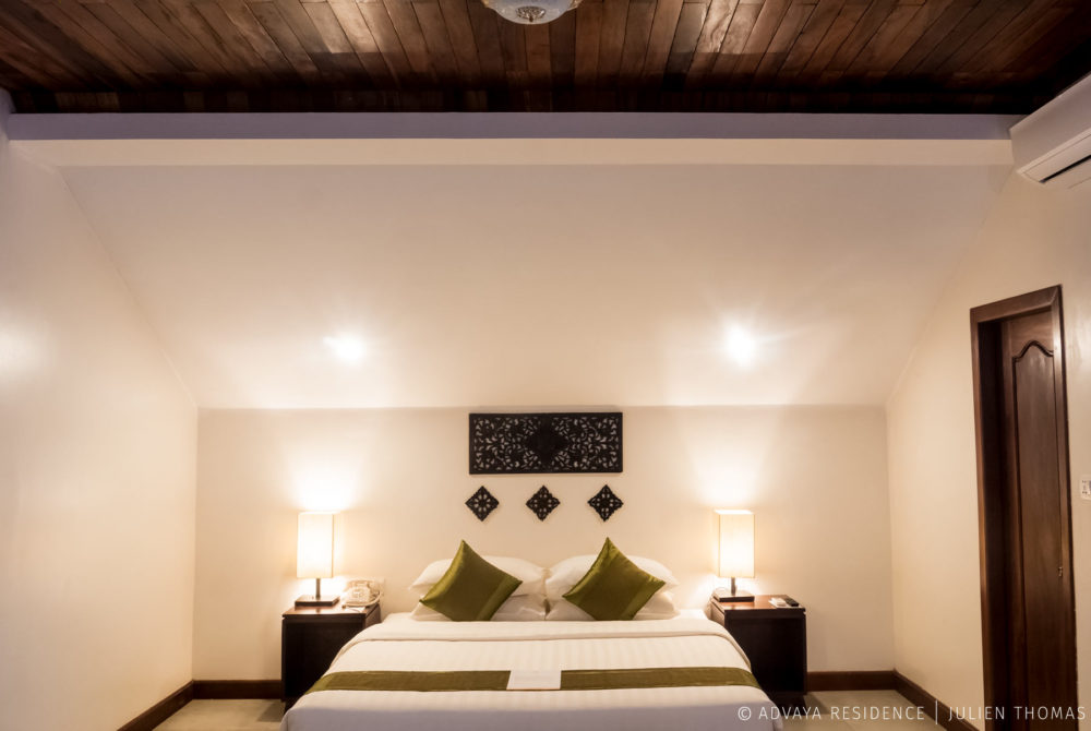 Studio Room with access to private bathroom, telephone to the hotel receptionist, air conditioner and ceiling light in Advaya Residence, Siem Reap - Cambodia.