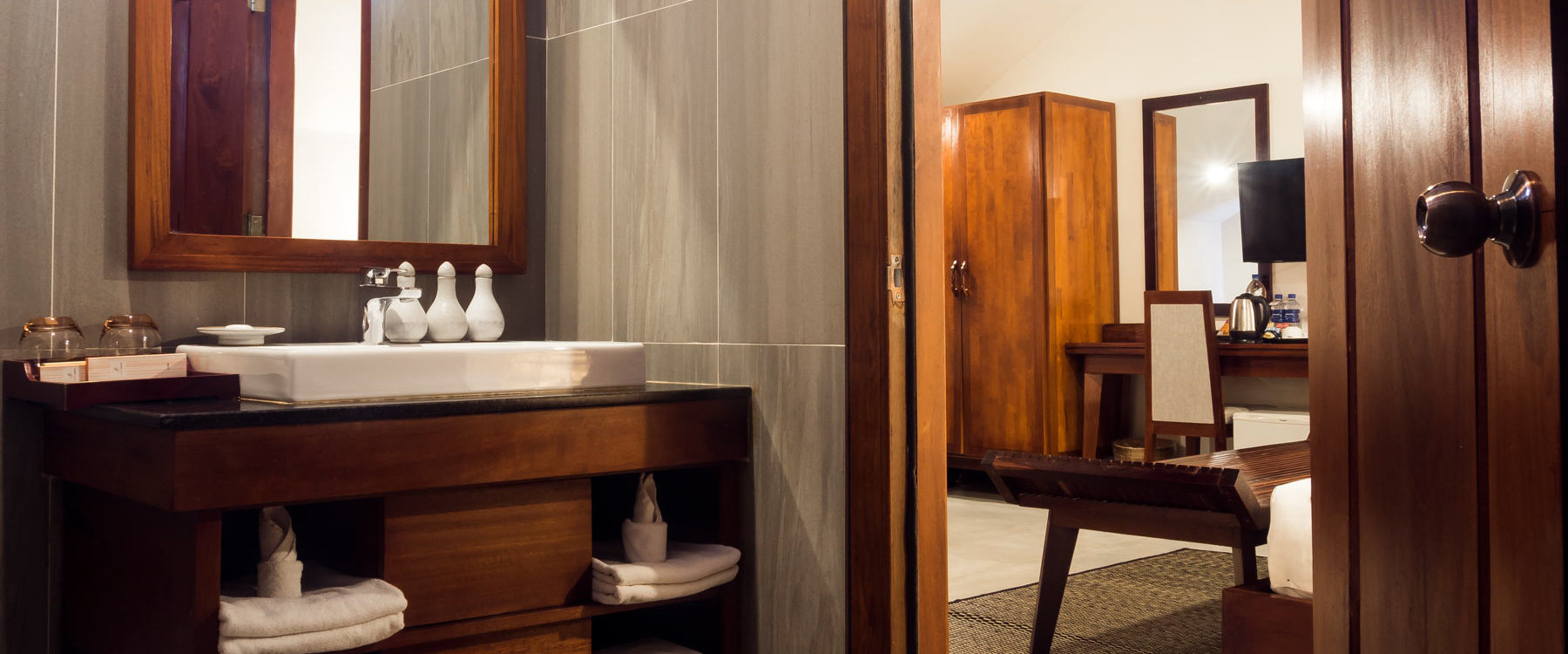 High standard private bathroom fully furnished in a Studio Room with tiles floor, wardrobe and televisor in Advaya Residence in Siem Reap - Cambodia.