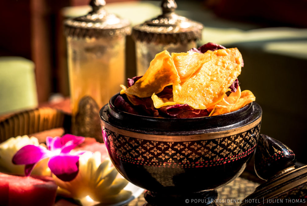 Welcoming snack platter with fruits, house drink and potato chips for the travelers booking in Popular Residence Hotel, Siem Reap - Cambodia.