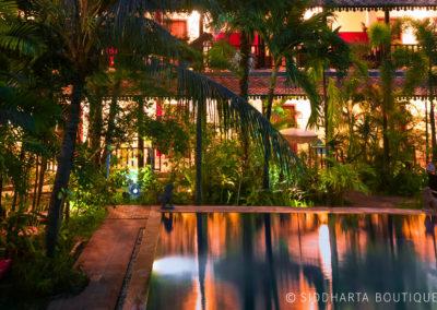 hotel-garden-pool-room-night