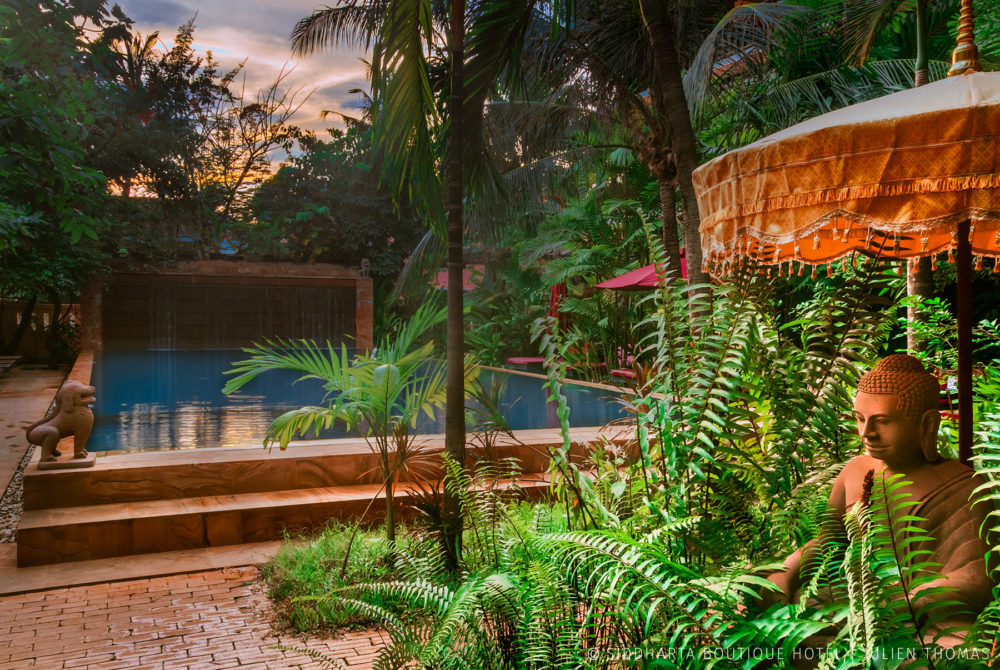 Swimming pool during sunset in Siddharta Boutique Hotel, Siem Reap - Cambodia.