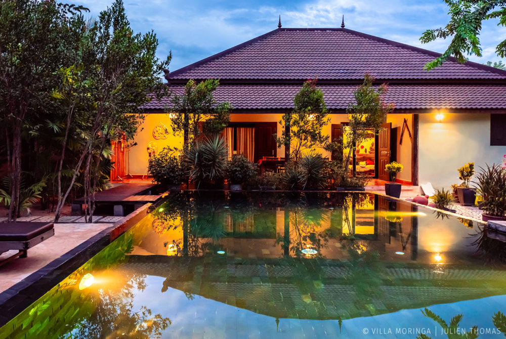 Villa house accommodation to rent with a swimming pool during sunset in villa Moringa, Siem Reap - Cambodia.