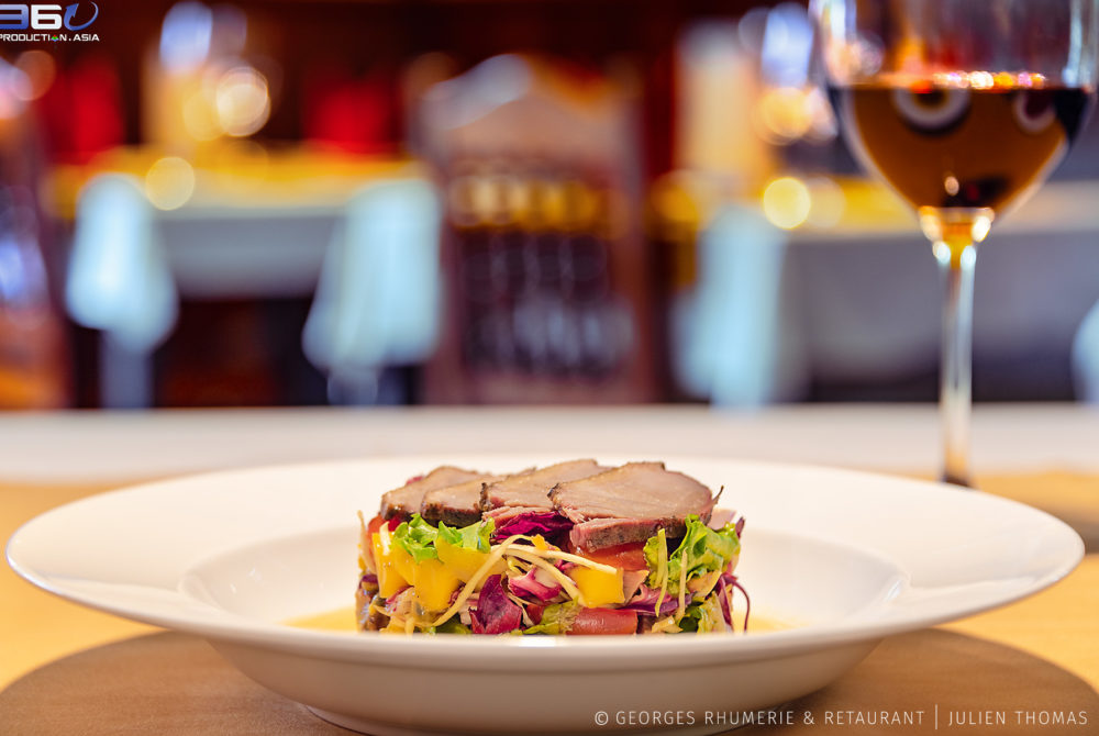 In house smocked duck in the exotic salad (passion fruit, mango and organic salad). Smocked duck Salad